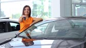 adult : Girl selling car at car sales center (PAL) Stock Footage