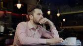 devaluation : sad young business man in a bar Stock Footage