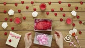 creepy : Man gets plastic human heart as strange holiday present from his loved one, top view Stock Footage
