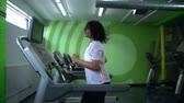 runners : African American woman working on a treadmill in the gym