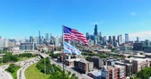 chicago : Aerial drone shot of Chicago downtown above the highway with american flag. USA Flag in the middle.