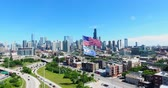 Aerial drone shot of Chicago downtown above the highway with american flag. USA Flag in the middle.