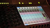 leva : Professional audio Mixer and Professional Headphones in the Recording Studio. Sound Mixing Desk.