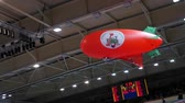 zeplin : 10.14.2017 Novosibirsk, the Volleyball teams match. Red airship flies through the stadium during a break at a match