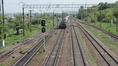 wagons : LVIV, UKRAINE - MAY 2018: A freight train rides the railway station Stock Footage