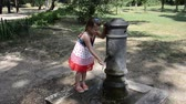 nariz : Girl drinking water from the drinking fountain