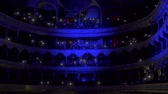 concertgebouw : Hall of the Opera House with people with lights on, luminous telephones