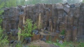 basalto : basalt columns in the pouring rain in nature