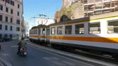 tranças : Tram with three wagons, Rome. Italy - February 23, 2015: in Rome about 39 km tram tram tracks and 192 stops .. UltraHD 4K Stock Footage