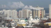 roof : Smoke from the pipes against the backdrop of the city. Ekaterinburg. UltraHD (4K)