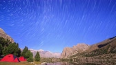 constellations : Moonlit night in the mountains. Traces of stars similar to metory. Time Lapse. Pamir, Tajikistan