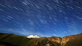 high plateau : Stars draw lines and clouds over Mount Elbrus. Night landscape. Russia