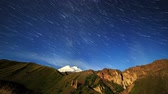 planalto : Stars draw fading lines and clouds over Mount Elbrus. Night landscape. Russia