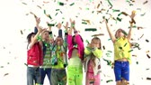 decor : Kids Jumping And Having Fun In A Scattered Confetti Stock Footage