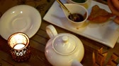 cena urbana : White teapot and cup on a table in city cafe Stock Footage