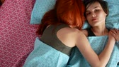 lesbian : Lesbian couple cuddling in bed at home in the bedroom. Stock Footage