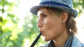 смаковать : women smoking hookah in open air, woman pull hookah in parkland, beautiful girl outdoors, lovely female into hale taste tobacco on vacation