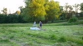 living environment : Husband and wife are dragging hay. Rural everyday life. Stock Footage