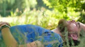 queensland : A young man enjoys the nature of lying on the ground. Stock Footage