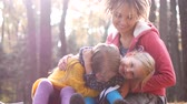 backyard : Mom with little girls on a picnic in the autumn forest.