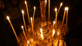 алтарь : Burning candle closeup on the background of other candles in the Christian Orthodox Church.