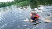 drowning : the boy floats in the river, the life jacket in action.