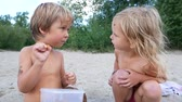 veg : boy and girl are having dinner on the beach.