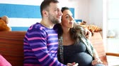 analık : Couple With Pregnant Woman Relaxing On Sofa.