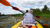 canoe : A child paddles on a kayak paddle. Active family vacation