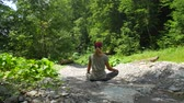 sincérité : Caucasian woman meditating in a forest in a clearing. Calm in pure nature