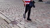 rehber : Blind man walks on the sidewalk with a cane. Stok Video