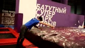 Trampoline spinning and jumping acrobatic stunts and tricks. Slow-motion. Stock mozgókép
