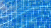 water ripples in swimming pool, blue tile background