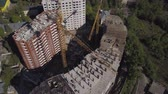 urban development : Aerial view of building cranes and buildings under construction