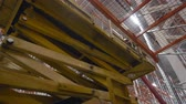 produktivita : Scissor Lift work inside a new modern warehouse