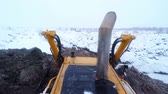 bauxite : Bulldozer and Excavator machine working with ground on snow winter day. View from cabin Stock Footage