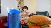 objection : young man moving away plate with junk food Stock Footage