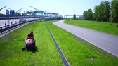 lawnmowing : RUSSIA ST.PETERBURG- 28 MAY 2016: Aerial view of Road landscaper cutting grass along the modern highway Stock Footage