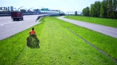 lawnmowing : Aerial view of Road landscaper cutting grass along the modern highway
