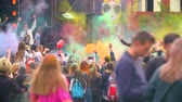 holi : RUSSIA ST.PETERBURG- 8 JUNE 2016: crowd of happy people throw up the paint. festival of colors Holi