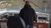 congratulação : Skipper on captain bridge during sea walk on background green hill on coast Italy Stock Footage