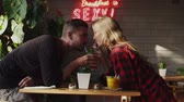 sweetheart : Lovers drinking one cocktail through different straws Stock Footage