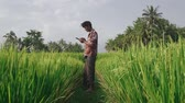 reap : Indian male farmer using mobile phone