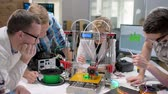 technik : Multiethnic Students Discussing 3D Printed Mechanism in a New Modern Laboratory. Dostupné videozáznamy