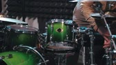 naladit : Musician in sunglasses tuning drum set