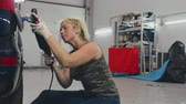 waxing : Woman worker making car body polishing with polisher in service.