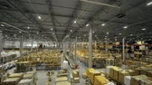 отправка : Boxes with goods on high racks in warehouse on manufacturing plant drone view