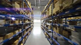 депо : Boxes on high shelves at storehouse. Finished goods in boxes in trading warehouse
