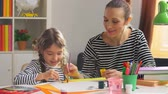 the conception : Beautiful mother and daughter painting together