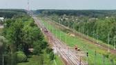 Top view passenger train rides from city to village through countryside